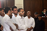 Egyptian defendants in the trial of US embassy violence stand in the court room during their trial in Cairo on April 2, 2015. The Cairo Criminal Court delayed the trial of 23 of members of Muslim Brotherhood accusing in the violence outside the US embassy on July 2013 to hear the witnesses on April 23. Photo by Stringer