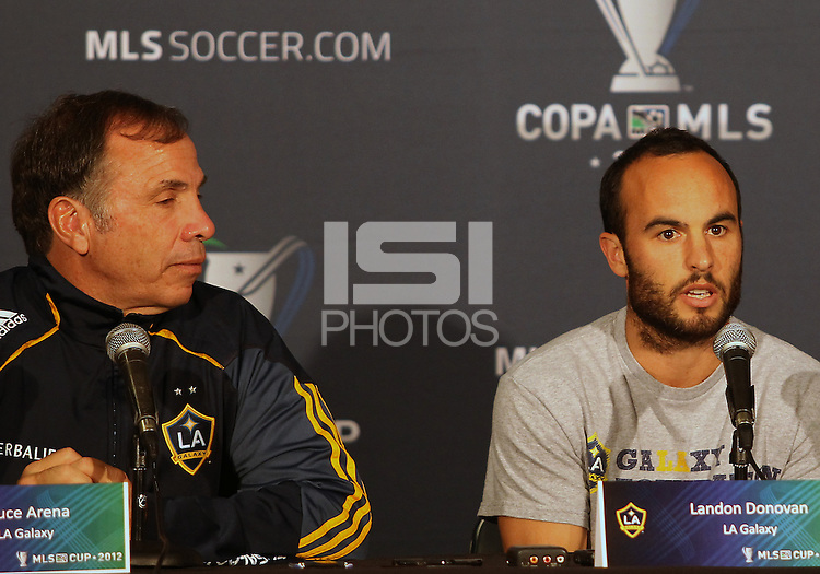 CARSON, CA - NOVEMBER 30, 2012: Coach Bruce Arena of the Los Angeles Galaxy with  Landon Donovan (10) during a press conference at Home Depot Center, in Carson, CA, before the 2012 MLS Cup, on November 30, 2012.