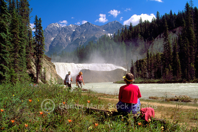 Yoho National Park, Canadian Rockies, BC, British Columbia, Canada - Hikers walking and resting beside Wapta Falls, Kicking Horse River, Summer - Model Released Person in foreground