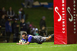 Aaron Cruden dives over to score for the All Blacks. The game of Three Halves, a pre-season warm-up game between the Counties Manukau Steelers, Northland and the All Blacks, played at ECOLight Stadium, Pukekohe, on Friday August 12th 2016. Photo by Richard Spranger.
