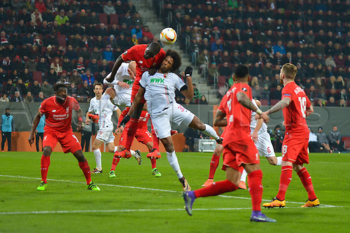 18.02.2016. Augsburg, Germany. UEFA Europa League football. Augsburg versus Liverpool FC.  CAIUBY (FC Augsburg) loses the header to Kolo Toure (FC Liverpool)