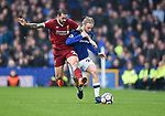 Tom Davies of Everton is challenged by Danny Ings of Liverpool during the premier league match at Goodison Park Stadium, Liverpool. Picture date 7th April 2018. Picture credit should read: Robin Parker/Sportimage
