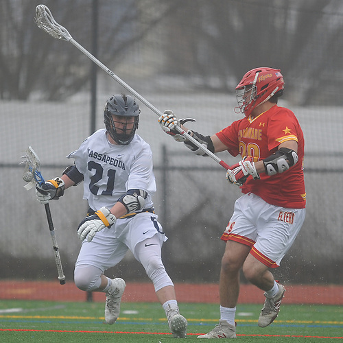 Frank Marinello #29, Chaminade defenseman, right, puts pressure on Timmy Ley #21 of Massapequa during a non-league varsity boys lacrosse game at Massapequa High School on Wednesday, April 4, 2018. Chaminade won by a score of 8-5.