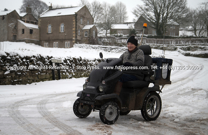 21/01/15<br /> <br /> A hardy pensioner takes on the snow in Hartington, Derbyshire.<br /> <br /> More than 20 schools in Derbyshire were closed today following overnight snowfall that continued into the morning across the Peak District.<br /> <br /> All Rights Reserved - F Stop Press.  www.fstoppress.com. Tel: +44 (0)1335 300098