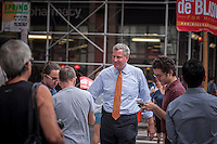 """New York Mayoral candidate and Public Advocate Bill DeBlasio does a """"meet and greet"""" campaign event in front of the newly opened Fairway supermarket in the Chelsea neighborhood of New York on Tuesday, July 30, 2013. In the seemingly never ending battle for City Hall DeBlasio has been placed as number two behind Christine Quinn in recent polls.  (© Richard B. Levine)"""