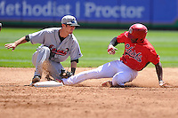 Brandon Trinkwon #9 of the Great Lakes Loons tags out Peoria runner at second base against the Peoria Chiefs at Dozer Park on July 28, 2014 in Peoria, Illinois. The Loons won 4-0.   (Dennis Hubbard/Four Seam Images)