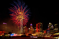 Fireworks from Skyshow Charlotte  2017 explode over BB&amp;T Ballpark against the backdrop of the Charlotte NC skyline as the city celebrated the July 4th holiday in 2017. Photographer has fireworks celebrations in Charlotte from multiple years. The collection of Charlotte NC fireworks photos show different perspectives and weather conditions.<br /> <br /> Charlotte Photographer - PatrickSchneiderPhoto.com