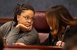 Nevada Assembly Democrats Dina Neal, left, and Teresa Benitez-Thompson work in committee at the Legislative Building in Carson City, Nev. on Tuesday, Feb. 5, 2013. .Photo by Cathleen Allison
