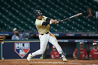 Jayson Gonzalez (99) of the Vanderbilt Commodores follows through on his swing against the Houston Cougars during game nine of the 2018 Shriners Hospitals for Children College Classic at Minute Maid Park on March 3, 2018 in Houston, Texas. The Commodores defeated the Cougars 9-4. (Brian Westerholt/Four Seam Images)