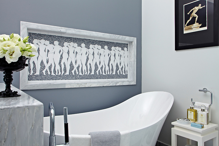 This custom handmade Muse mosaic shown in Thassos and Bardiglio is shown here in a bath designed by Alissa Madden of Madden Design, San Francisco.<br />