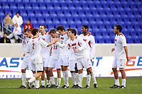 Charlie Campbell (2) of the Louisville Cardinals celebrates scoring a penalty kick with teammates. The Louisville Cardinals defeated the Providence Friars 3-2 in penalty kicks after playing to a 1-1 tie during the finals of the Big East Men's Soccer Championship at Red Bull Arena in Harrison, NJ, on November 14, 2010.