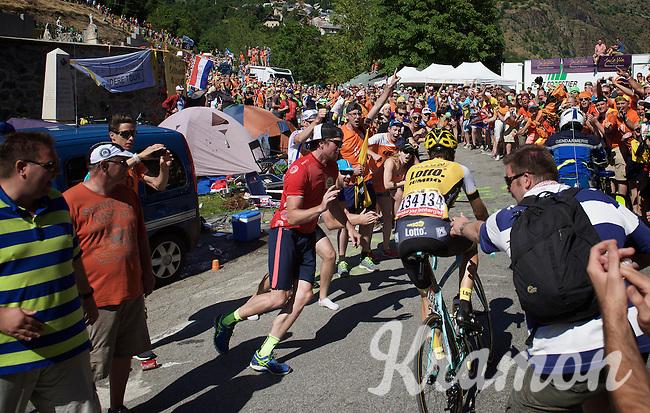 Tom Leezer (NLD/LottoNL-Jumbo) experiencing the craziness at the Dutch Corner (nr7) up Alpe d'Huez as he gets a little push by the fans<br /> <br /> stage 20: Modane Valfréjus - Alpe d'Huez (111km)<br /> 2015 Tour de France