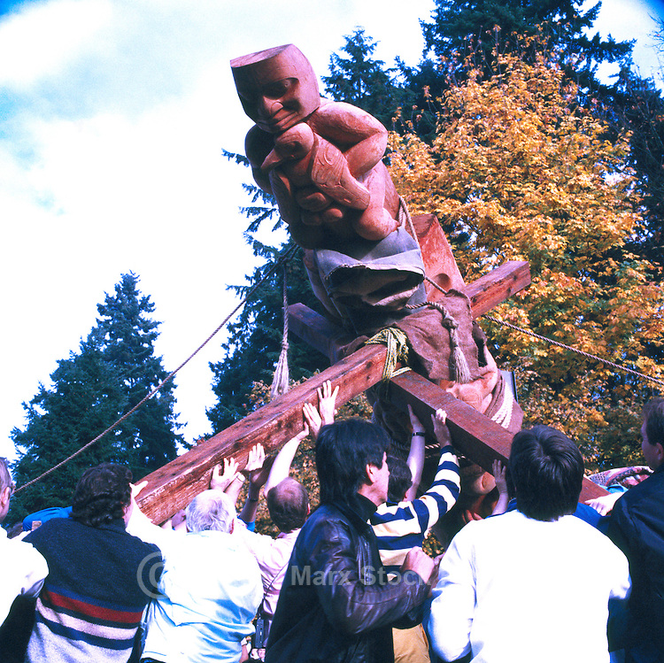 Stanley Park, Vancouver, BC, British Columbia, Canada - Native American Indians erecting  Nisga'a Totem Pole at Brockton Point