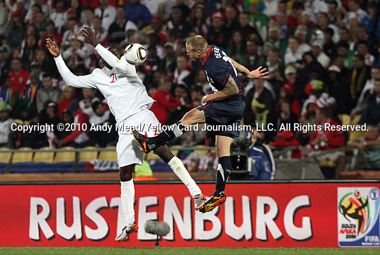 12 JUN 2010:  Emile Heskey (ENG)(21) and Jay DeMerit (USA)(right) vie for a head ball.  The England National Team and the United States National Team were tied 1-1 after the first half at Royal Bafokeng Stadium in Rustenburg, South Africa in a 2010 FIFA World Cup Group C match.