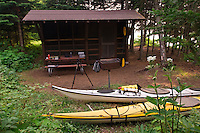 Kayakers use a backcountry shelter at Isle Royale National Park.
