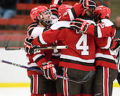 Nick Pitsikoulis (St. Lawrence - 22) and his Saints teammates celebrate Child's goal which opened scoring early in the first period. - The Harvard University Crimson defeated the St. Lawrence University Saints 4-3 on senior night Saturday, February 26, 2011, at Bright Hockey Center in Cambridge, Massachusetts.