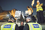 © Joel Goodman - 07973 332324 . 05/11/2016 . London , UK . Police carry out stop and searches on supporters of Anonymous , many wearing Guy Fawkes masks , attending the Million Mask March bonfire night demonstration , at Trafalgar Square , in central London . Photo credit : Joel Goodman