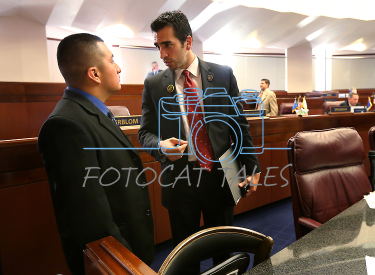 Nevada Sen. Ruben Kihuen, D-Las Vegas, right, talks with Frankie Perez on the Senate floor at the Legislative Building in Carson City, Nev., on Tuesday, May 21, 2013. <br /> Photo by Cathleen Allison