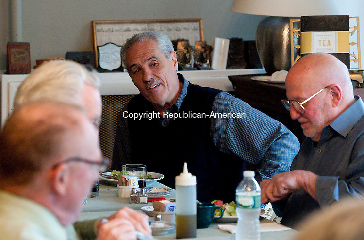 WATERBURY, CT--042215JS01- Bill DeMaido of Waterbury, center, introduces himself during a dinner Wednesday at John Bale Bookstore in Waterbury. Local residents were invited to the event to talk about positive changes that could be implemented in the city of Waterbury. <br /> Jim Shannon Republican-American