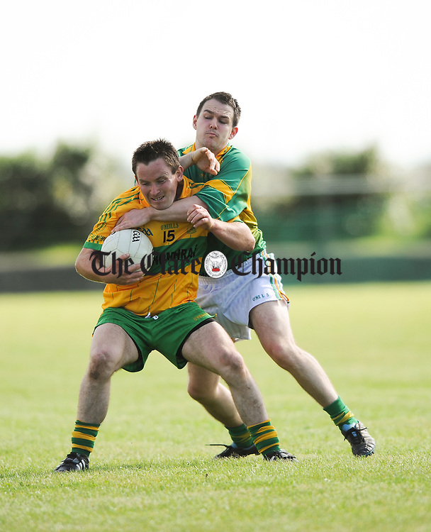 Damien Carmody of O Currys in action against Paul Reddan of Kilfenora during their Intermediate semi final at Doonbeg. Photograph by John Kelly.