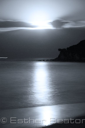Full moon rising over ocean at Pearl Beach, Central Coast, New South Wales. At about 6:30 pm in August.