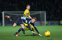 Chris Maguire of Oxford United plays the ball past Jason McCarthy of Wycombe Wanderers during the Sky Bet League 2 match between Wycombe Wanderers and Oxford United at Adams Park, High Wycombe, England on 19 December 2015. Photo by Andy Rowland.