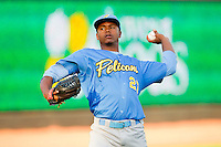 Starting pitcher Victor Payano (27) of the Myrtle Beach Pelicans warms up in the outfield prior to the game against the Winston-Salem Dash at BB&T Ballpark on May 15, 2013 in Winston-Salem, North Carolina.  The Pelicans defeated the Dash 9-2.  (Brian Westerholt/Four Seam Images)