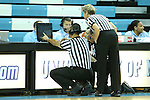 24 November 2012: Referees Billy Smith, Joseph Vaszily, Dawn Marsh review a controversial play on a monitor during the second half. The University of North Carolina Tar Heels played the La Salle University Explorers at Carmichael Arena in Chapel Hill, North Carolina in an NCAA Division I Women's Basketball game. UNC won the game 85-55.