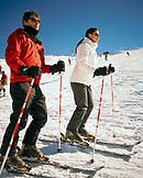 ARGENTINA, Bariloche, Cerro Cathedral, close-up of people skiing on snow capped mountain