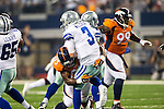 Dallas Cowboys quarterback Brandon Weeden (3) and Denver Broncos defensive end Quanterus Smith (93) in action during the pre-season game between the Denver Broncos and the Dallas Cowboys at the AT & T stadium in Arlington, Texas. Denver leads Dallas 10 to 3 at halftime.