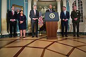 From left to right: Special Presidential Envoy for the Global Coalition to Counter ISIL Brett McGurk, United States Attorney General Loretta Lynch, US Secretary of State John Kerry, US Secretary of Defense Ashton Carter, and Chairman of the Joint Chiefs of Staff General Joseph Dunford stand alongside US President Barack Obama as he makes a statement after meeting with his National Security Council at the State Department, February 25, 2016 in Washington, DC. The meeting focused on the situation with ISIS and Syria, along with other regional issues.<br /> Credit: Drew Angerer / Pool via CNP