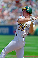 OAKLAND, CA - Mark McGwire of the Oakland Athletics bats during a game at the Oakland Coliseum in Oakland, California in 1992. Photo by Brad Mangin