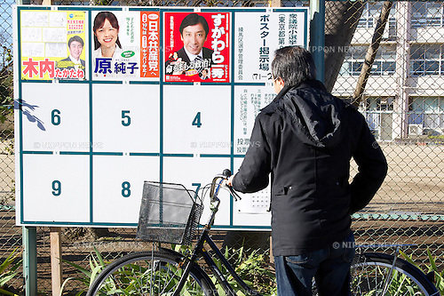 People come to vote early in the morning for Lower House election on December 14, 2014. The Japan's general election has started throughout the country with more than 48,000 polling stations opened on Sunday from 7am to 8pm. In this election 1191 candidates are vying for 475 seats. The vote counting will start at 8pm. (Photo by Rodrigo Reyes Marin/AFLO)