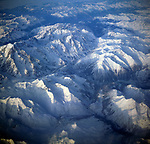 A3AAM4 Aerial view of alpine mountain peaks covered by ice and snow