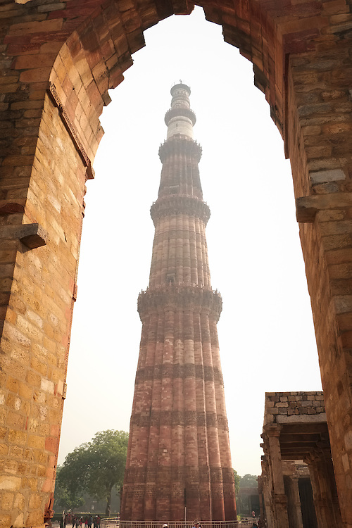 The majestic Qutub Minor monument towers 238 feet above the wide plains of Delhi.