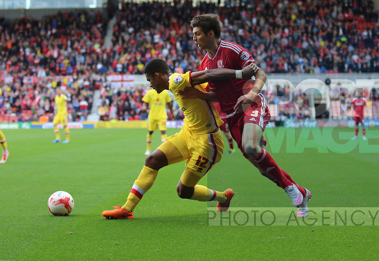 Jordan Spence of MK Dons stopping George Friend of Middlesbrough getting to the ball - Sky Bet Championship - Middlesbrough v MK Dons - Riverside Stadium - Middlesbrough - England - 12th September 2015 - Picture Jamie Tyerman/Sportimage