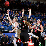 BROOKINGS, SD - MARCH 16:  Madison Guebert #11 from South Dakota State University scoops a shot past Courtney Woods #4 from Northern Illinois during their first round WNIT game Thursday at Frost Arena in Brookings.(Photo by Dave Eggen/Inertia)