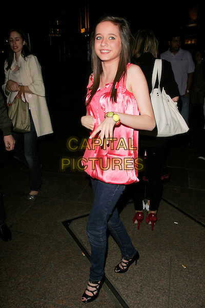 "MADELINE DUGGAN.UK Premiere of ""Hannah Montana: The Movie"" at the Odeon Leicester Square, London, England. .April 23rd 2009 .full length pink top jeans black shoes peep toe straps buckles silk satin patent hand bracelet green .CAP/AH.©Adam Houghton/Capital Pictures."