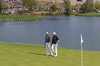 Bubba Watson and Webb Simpson (Team USA) on the 1st green during the Friday Foursomes at the Ryder Cup, Le Golf National, Ile-de-France, France. 28/09/2018.<br /> Picture Thos Caffrey / Golffile.ie<br /> <br /> All photo usage must carry mandatory copyright credit (&copy; Golffile | Thos Caffrey)
