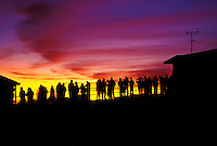 A line of people view a beautiful Haleakala sunrise