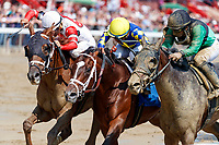 Scenes from around Saratoga Race Course, Sept 4.  Unexplained (No. 6, inside horse) wins the second race in a three-horse photo finish. Ridden by Rajiv Maragh and trained by Danny Gargan.   (Bruce Dudek/Eclipse Sportswire)