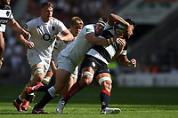 Paul Hill of the England XV tackles Liam Messam of the Barbarians. Quilter Cup International match between England XV and the Barbarians on June 2, 2019 at Twickenham Stadium in London, England. Photo by: Patrick Khachfe / Onside Images