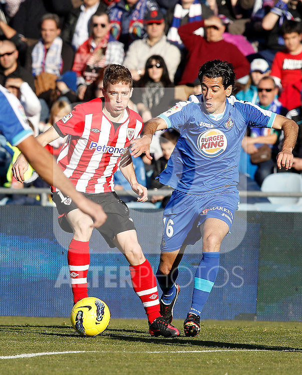 Getafe's Pedro Rios against Athletic de Bilbao's Iker Muniain during La Liga Match. January 08, 2012. (ALTERPHOTOS/Alvaro Hernandez)