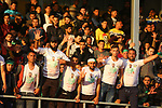 Fans react as Palestinian Etihad Khan Younis players (red) and Khadamat Rafah  players (green) compete during the final match in al-Quds premier league, at Khan Younis stadium, in the southern Gaza Strip on March 10, 2019. Photo by Wael al-Halabi