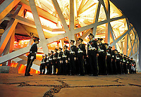 Aug. 8, 2008; Beijing, CHINA; Chinese military personnel stand in ranks following the opening ceremonies for the 2008 Beijing Olympic Games at the National Stadium. Mandatory Credit: Mark J. Rebilas-
