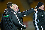 St Johnstone v Aberdeen...13.12.11   SPL .Craig Brown talks with fourth official Euan Norris after Andrew Considine was sent off.Picture by Graeme Hart..Copyright Perthshire Picture Agency.Tel: 01738 623350  Mobile: 07990 594431
