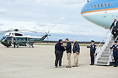United States President Barack Obama and FEMA Administrator Craig Fugate greet New Jersey Governor Chris Christie on the tarmac of Atlantic City International Airport in Atlantic City, New Jersey, Wednesday, October 31, 2012. .Mandatory Credit: Chuck Kennedy - White House via CNP