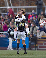 Boston College defender Hannah Cerrone (11) and Boston College goalkeeper Jillian Mastroianni (30) celebrate victory. Boston College defeated Hofstra University, 3-1, in second round NCAA tournament match at Newton Soccer Field, Newton, MA.