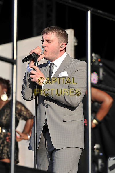 Plan B (Ben Drew) .Performs on during Day One of Wireless Festival, Hyde Park, London, England, UK, 1st July 2011..half length music live on stage concert gig grey gray suit white shirt tie microphone singing .CAP/MAR.© Martin Harris/Capital Pictures.