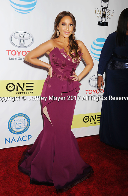 PASADENA, CA - FEBRUARY 11: Actress-singer Adrienne Bailon arrives at the 48th NAACP Image Awards at Pasadena Civic Auditorium on February 11, 2017 in Pasadena, California.